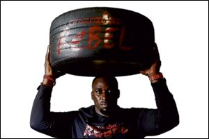 Amen Iseghohi's studio features a high-intensity workout that uses the tires as weights and steps and obstacles.