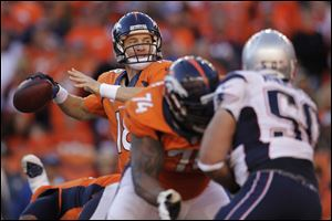 Broncos quarterback Peyton Manning threw for 400 yards and two touchdowns Sunday to lead Denver to its first trip to the NFL title game in 15 years. The Broncos beat the New England Patriots 26-16.