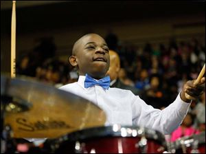 Jonathan Williams, 14, plays drums with The Toledo Community Youth Choir.