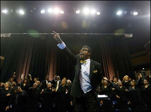 Dr. Derrick Roberts conducts The Toledo Interfaith Mass Choir during the event at the University of Toledo.