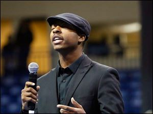 MADD Poets Society member Trayvone Mathis, 19, performs a poem during the unity celebration.
