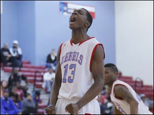 Bowsher High School player Dajuan King screams after his score.