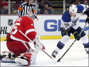Detroit Red Wings goalie Jimmy Howard stops a St. Louis Blues wing T.J. Oshie (74) shot in the first period Monday in Detroit.