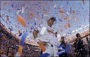 Broncos quarterback Peyton Manning is engulfed in confetti during the trophy ceremony Sunday in. The Broncos defeated the Patriots 26-16 to advance to the Super Bowl.