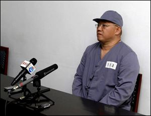 American missionary Kenneth Bae speaks to reporters at Pyongyang Friendship Hospital in Pyongyang Monday, Jan. 20. Bae, 45, who has been jailed in North Korea for more than a year.