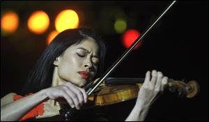 Internationally renown  violinist Vanessa Mae as she performs during her concert in Prague, Czech Republic in 2010.