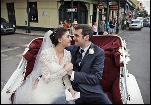 Shannon and Justin Peach ride in a carriage after their wedding in New Orleans in October, 2013. Shannon's mom, Cheryl Winter, spent $500 for Hartford-based Travelers Insurance to cover her daughter's destination wedding, where her biggest concern was a potential hurricane. The weather cooperated, but after the limousine failed to show they used the insurance policy to claim the deposit money they could not get back from the limo driver.