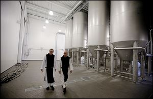 Father Damion, abbot at St. Joseph's Trappist Abbey, left, and Spencer Brewery director Father Isaac walk through their new, state-of-the-art facility in Spencer, Mass. The Spencer Brewery began brewing Spencer Trappist Ale recently becoming only the ninth certified brewery of Trappist beers in the world and the only one outside of Europe.