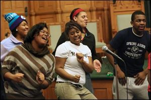 Bria Landry, 17, center, dances as the Toledo Youth Choir rehearses. A shared sound and common bond bring the 40 choir members a sense of belonging.