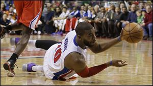Detroit Pistons forward Greg Monroe passes the ball during the first half today in Auburn Hills, Mich.