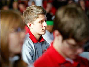 Central Catholic senior Jacob Braden, center, listens to speaker Jeff Wilbarger, not pictured, director of The Daughter Project, during the annual