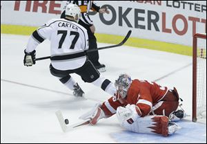 Detroit Red Wings goalie Jimmy Howard (35) stops a shot by Los Angeles Kings center Jeff Carter (77) during the shootout period of an NHL hockey game in Detroit, Saturday.