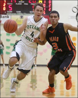 Ben Silverman drives past Gibsonburg's Isaih Arriaga. Silverman, a 5-foot-11 point guard, averages 7.3 points and 3.9 assists. He has made 20 of 21 free throws this season.  The senior has signed to play golf at Duke. Ottawa Hills finished 22-5 last year after losing in the Division IV regional final.