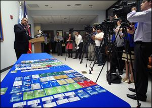 McAllen Police Chief Victor Rodriguez talks to media next to a dozens of fraudulent credit cards that were confiscated by McAllen police after arresting a man and a woman on fraud charges tied to the December Target credit card breach, Monday at the McAllen Police Department in McAllen, Texas.
