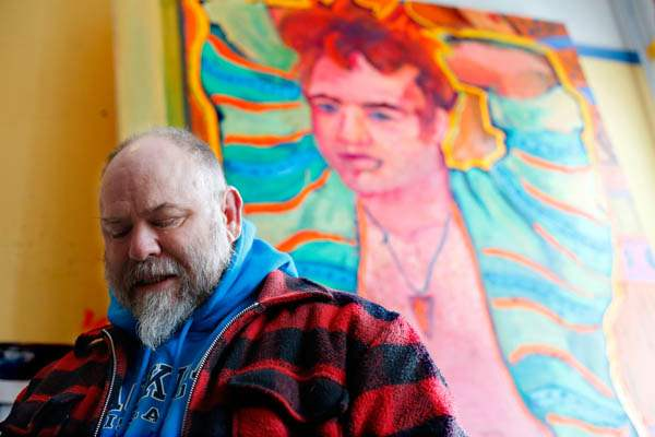 Local-artist-and-resident-Greg-Tarrant-stands-in-his-studio