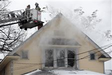 Fireman-on-the-scene-of-a-house-fire-on-Cottage-Street