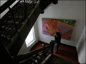 Local artist and resident Michael Grover walks down the stairs.