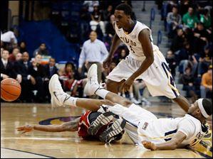 University of Toledo guard J.D. Weatherspoon (24) collides with Northern Illinois guard Travon Baker (5).