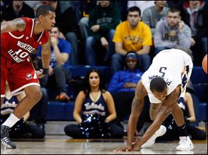 University of Toledo guard Rian Pearson (5) steals the ball from Northern Illinois forward Darrell Bowie (10).