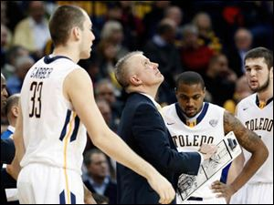 University of Toledo head coach Tod Kowalczyk goes over a play during a time out.