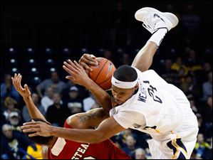 University of Toledo guard J.D. Weatherspoon (24) collides with Northern Illinois guard Aaron Armstead (2).