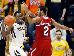 University of Toledo guard Justin Drummond (4) steals the ball from Northern Illinois guard Aaron Armstead (2).