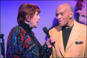 Annie Ross and Jon Hendricks sing together in New York. It was the first time the pair had sung together since 1999.