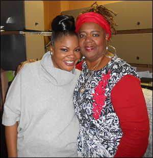 Monique, left, poses with Earlean Belcher, known as Queen Cookie the Comedian.