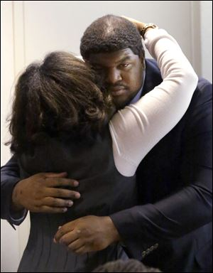 Former Dallas Cowboys NFL football player Josh Brent gets a hug from family after closing arguments in his intoxication manslaughter trial Tuesday, Jan. 21, 2014, in Dallas.
