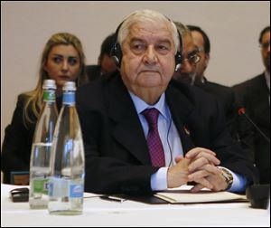 Syria's Foreign Minister Walid al-Moallem leads his delegation during a plenary session in Montreux, Switzerland, today.