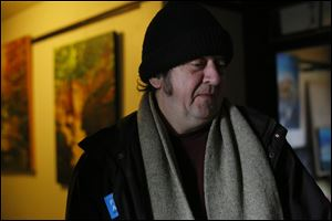 Local artist Jim Williams stands outside of his room surrounded by his artwork in the Collingwood Arts Center.