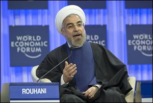 Iranian President Hassan Rouhani gestures as he speaks during a session of the World Economic Forum in Davos, Switzerland,