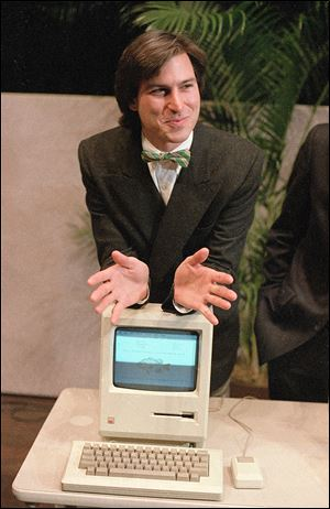 On Jan. 24, 1984, Steve Jobs, chairman of the board of Apple Computer, leans on the new 'Macintosh' in Cupertino, Calif. Early Macs showed a happy face when they started up.