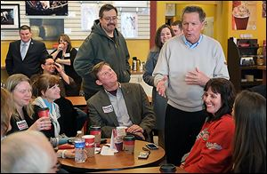 Gov. John Kasich speaks with supporters  in Findlay before he addressed the Wood County GOP's Lincoln Day Dinner.
