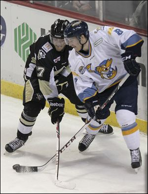 Bobby Shea, right, played in the first three games of the season for the Walleye and had one assist.