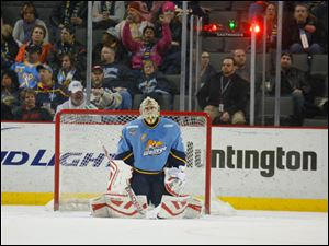 Toledo Walleye goalie Mac Carruth (31) reacts after giving up the second goal against the Wheeling Nailers.