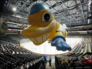 Toledo Walleye flying mascot Spike takes to the air before the Walleye play the Wheeling Nailers at the Huntington Center.