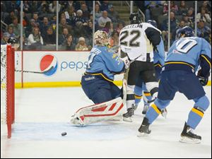 Toledo Walleye goalie Mac Carruth (31) can only watch as the puck slips behind him for a Wheeling Nailers goal during the second period.