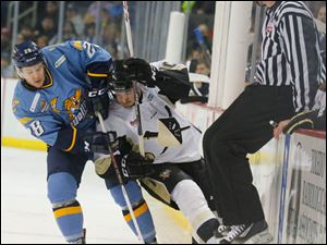 Toledo Walleye player Bobby Shea (28) battles Wheeling Nailers player Jacob Lagace (20) during the first period.