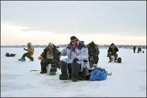 Anglers compete in the Midwest Open Ice Fishing Tournament at Devils Lake, Mich., last year. The event returns on Sunday.