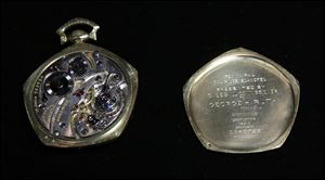 A the insides of a pocket watch that was given to Babe Ruth in 1923 is displayed at Heritage Auctions office in Dallas.