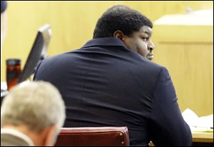 Former Dallas Cowboys player Josh Brent looks around in court during the penalty phase of the intoxication manslaughter trial in Dallas Thursday.