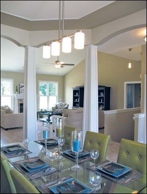 The dining room's tapered pillars and arches are just a few of the details you will find in a Josh Doyle home.