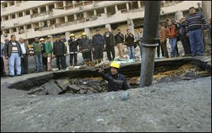 An Egyptian firefighter checks a crater made by a blast at the Egyptian police headquarters in downtown Cairo.