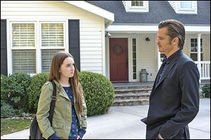 Kaitlyn Dever, left, as Loretta, Timothy Olyphant as Deputy U.S. Marshal Raylan Givens in the season 5 premier of 'Justified.'