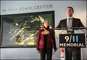 Alice Greenwald, director of the National Sept. 11 Memorial Museum, left, listens as Joseph Daniels, president of the National Sept. 11 Memorial, speak during a press conference on Friday in New York.