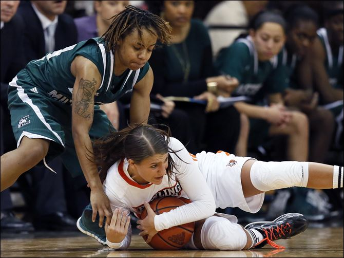 SPT BGwomen24p Bowling Green State University guard Jillian Halfhill (11) battles Eastern Michigan guard Cha Sweeney (24) for a loose ball, Thursday at the Stroh Center.
