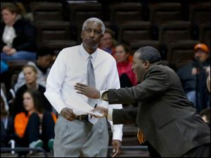 BGSU head coach Louis Orr walks past assistant coach Lamonta Stone as he gives direction to his players.
