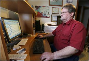 Toledoan Robert Geis checks online job sites that email him daily, but he has not yet found employment.