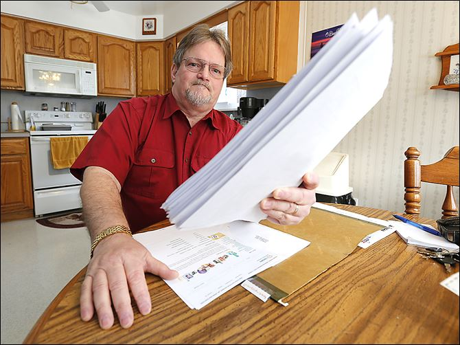 26n1jobless-3 Robert Geis holds a sheaf of job applications in his city home. Mr. Geis, who has been jobless since February, 2013, applies for 15 jobs per week on average.